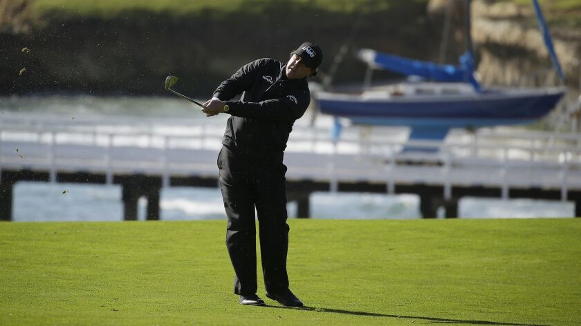 Phil Mickelson follows his approach shot from the fourth fairway during the final round of the Pebble Beach Pro-Am on Sunday.