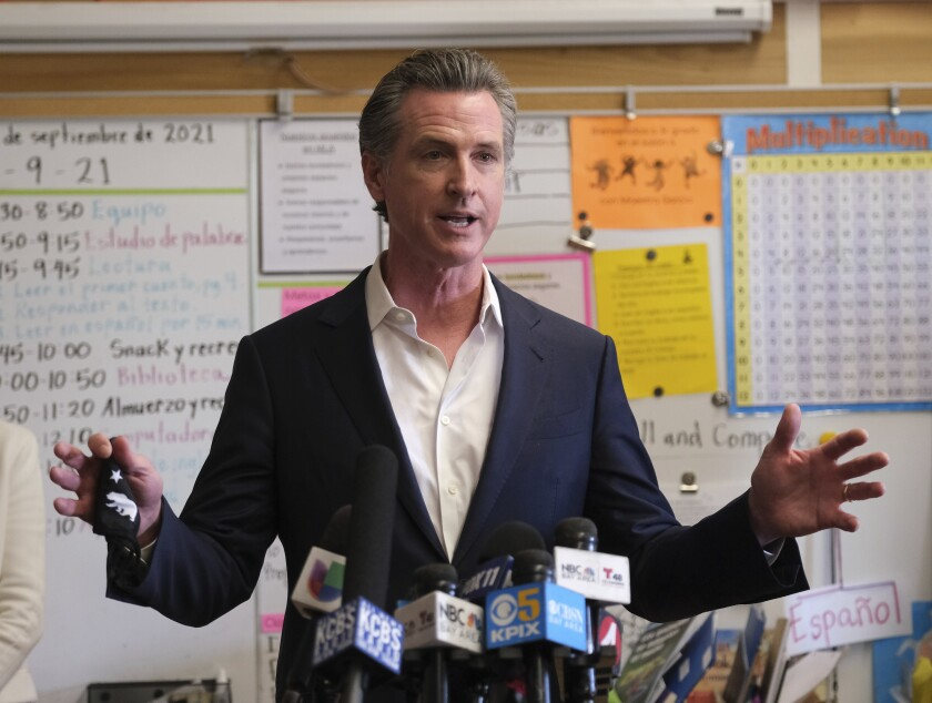 Gov. Gavin Newsom speaks to the press after visiting with students at Melrose Leadership Academy, a TK-8 school in Oakland, Calif., on Wednesday, Sept. 15, 2021, one day after defeating a Republican-led recall effort. (AP Photo/Nick Otto)