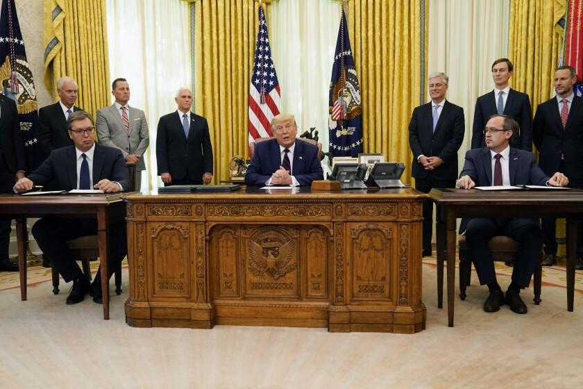 President Trump with Serbian President Aleksandar Vucic,  left, and Kosovar Prime Minister Avdullah Hoti in the Oval Office