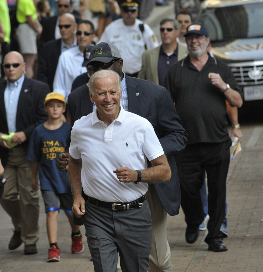 Vice President Joe Biden greets people as he walks along the Labor Day parade route in Pittsburgh.