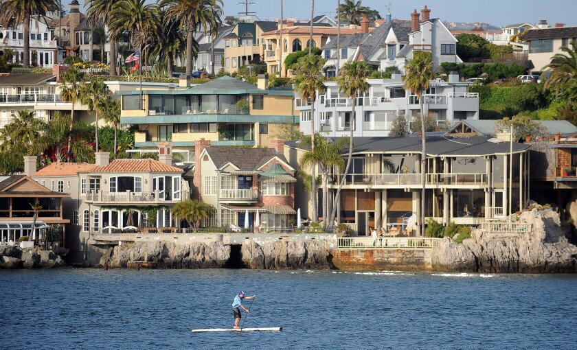 In Newport Beach in Southern California, city planners are looking into raising sea walls in waterfront neighborhoods like Balboa Island that are prone to flooding.