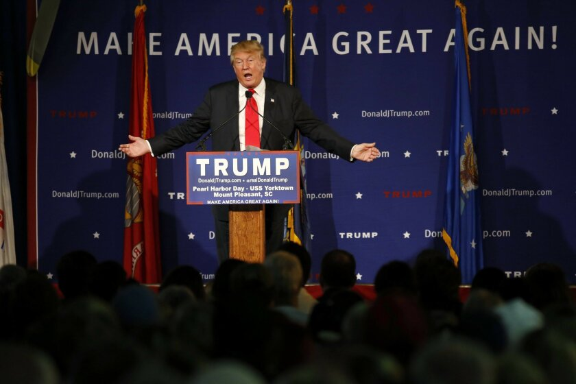 FILE - In this Dec. 7, 2015, file photo, Republican presidential candidate Donald Trump speaks during a rally coinciding with Pearl Harbor Day at Patriots Point aboard the aircraft carrier USS Yorktown in Mount Pleasant, S.C. Promising to tear up trade deals and tax imports, Trump taps into voter fears of foreign competition long unaddressed by the political system. But analysts say his ideas are misguided. (AP Photo/Mic Smith, File)