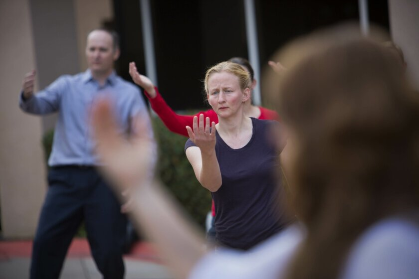 Navy Cmdr. Abigail Yablonsky, a Navy nurse practitioner, and Ph.D., along with other medical personnel learn tai chi, an internal Chinese martial art practiced for its health benefits as well as for defense training during a hands-on workshop during the Military and Veteran Resiliency Medicine Summit at the Balboa Naval Medical Center. Tai chi is one of the various alternative techniques to treat troops discussed and demonstrated during the summit.
