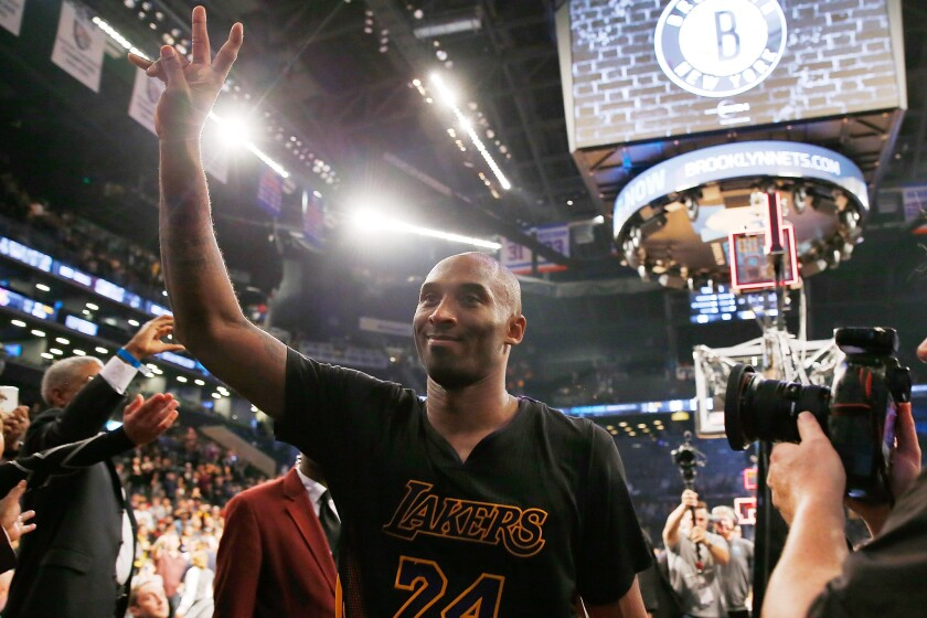 Kobe Bryant waves to the crowd after defeating the Brooklyn Nets, 104-98, at Barclays Center on Nov. 6.
