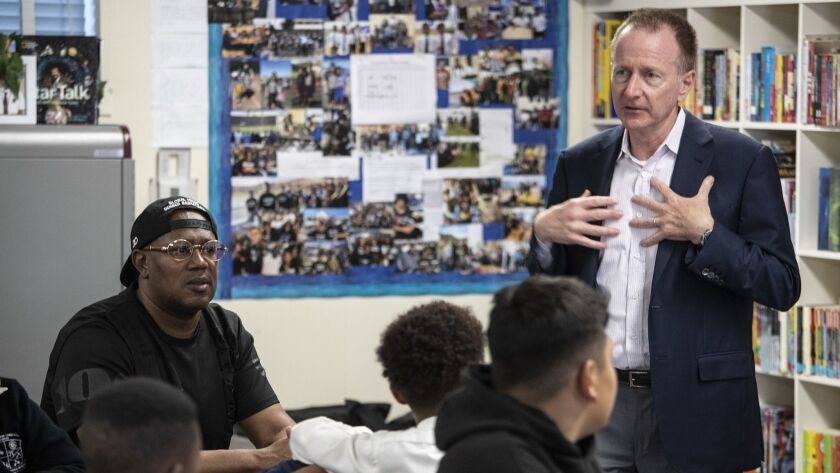 L.A. schools Supt. Austin Beutner, right, shown during a school visit in May, is taking public the district's case for its offer to break a contract negotiations stalemate with teachers.