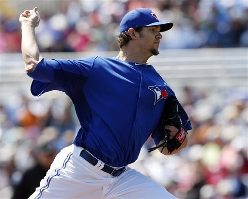Toronto Blue Jays starting pitcher Josh Johnson delivers against the New York Yankees during a spring training baseball game in Dunedin, Fla., Thursday, March 14, 2013. (AP Photo/Kathy Willens)