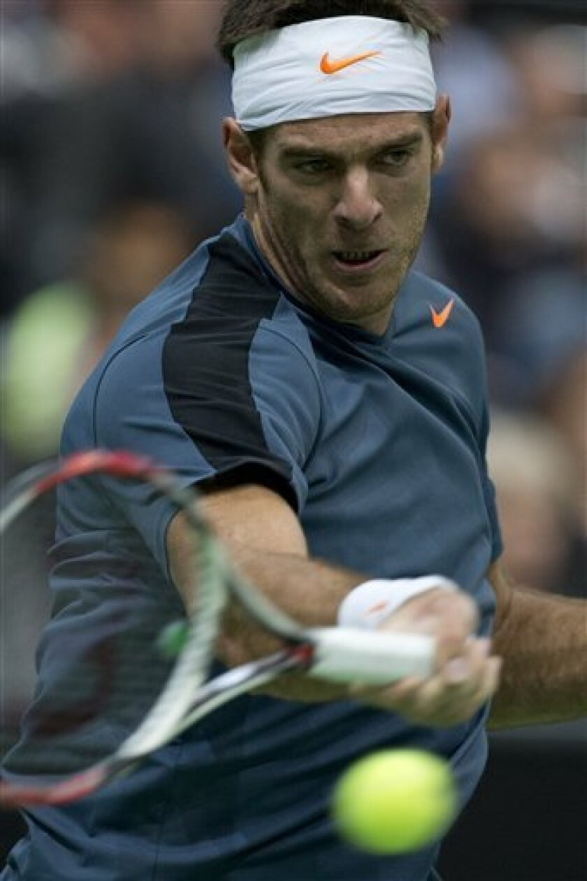 Juan Martin del Potro of Argentina returns a shot against Gael Monfils of France at the ABN AMRO world tennis tournament at Ahoy Arena in Rotterdam, Netherlands, Tuesday Feb. 12, 2013. (AP Photo/Peter Dejong)