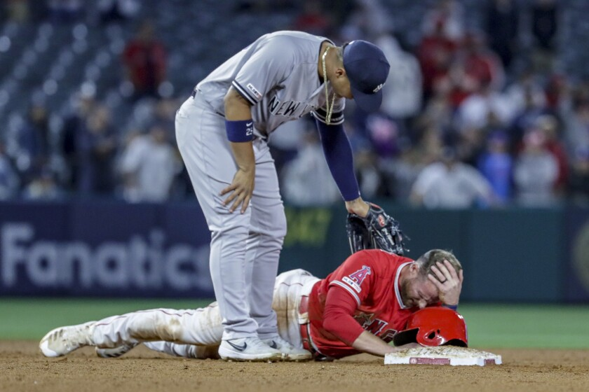 ANAHEIM, CA, MONDAY, APRIL 22, 2019 - Angels third baseman Zack Cozart lays at second base after hur