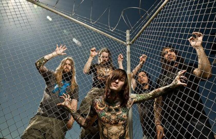Mitch Lucker, center, of Riverside's Suicide Silence, died Thursday.