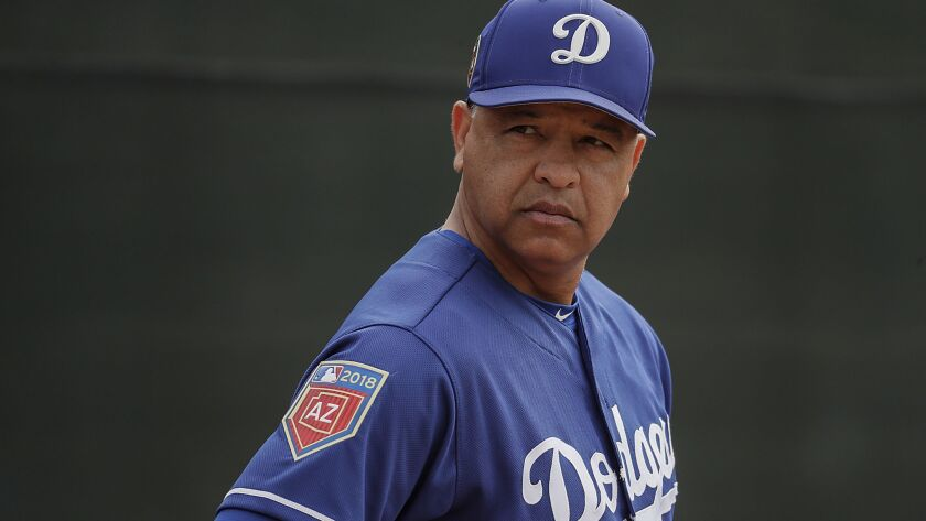 GLENDALE, ARIZONA, THURSDAY, FEBRUARY 15, 2018 - LA Dodgers manager Dave Roberts watches over a spri
