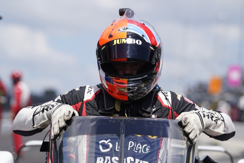 Rinus VeeKay, of the Netherlands, climbs out of his car during qualifications for the Indianapolis 500 auto race at Indianapolis Motor Speedway, Sunday, Aug. 16, 2020, in Indianapolis. (AP Photo/Darron Cummings)