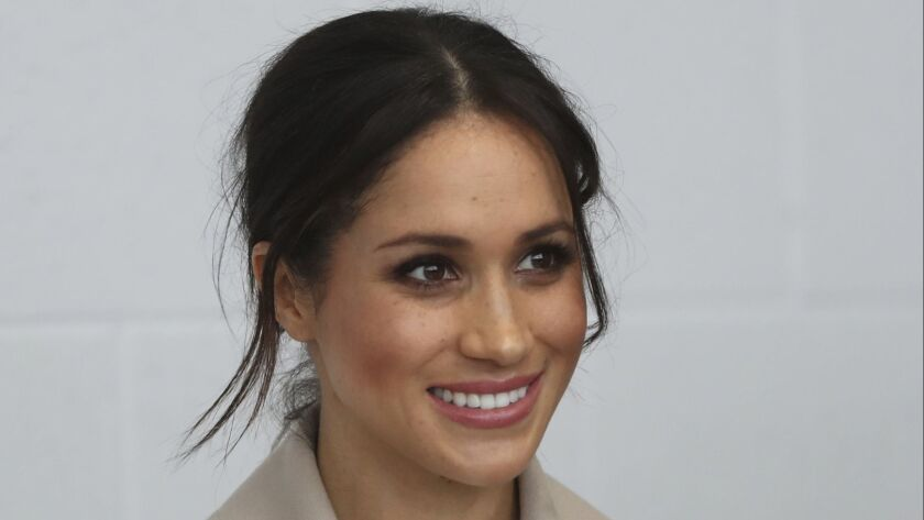 Meghan Markle smiles during a visit with Prince Harry to the Eikon Exhibition Centre in Lisburn, N