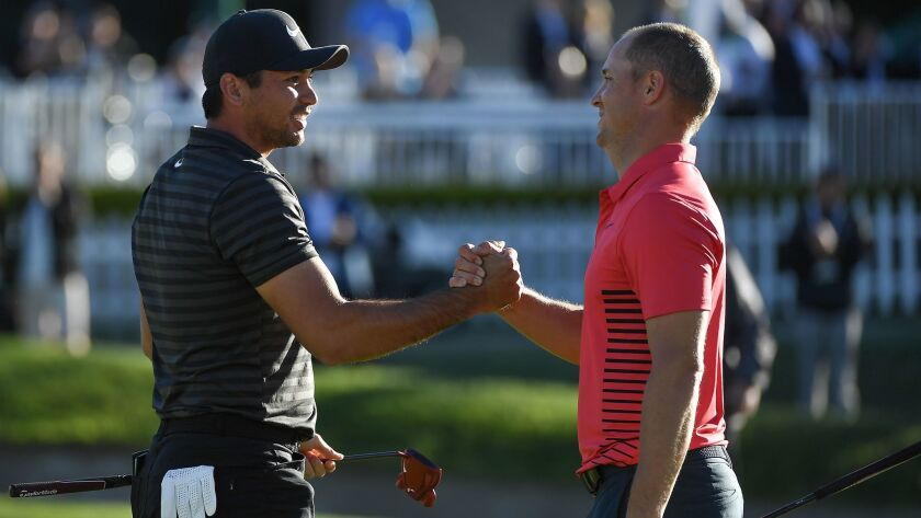 Jason Day, left, shakes hands with Alex Noren after winning the Farmers Insurance Open following their sixth playoff hole Monday at Torrey Pines South.