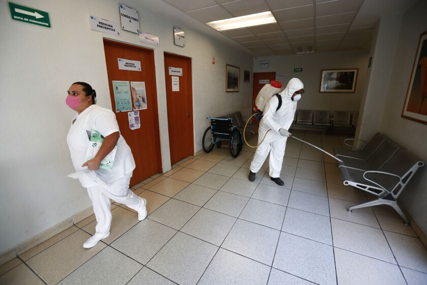 Workers sanitize a public hospital in Jalisco.