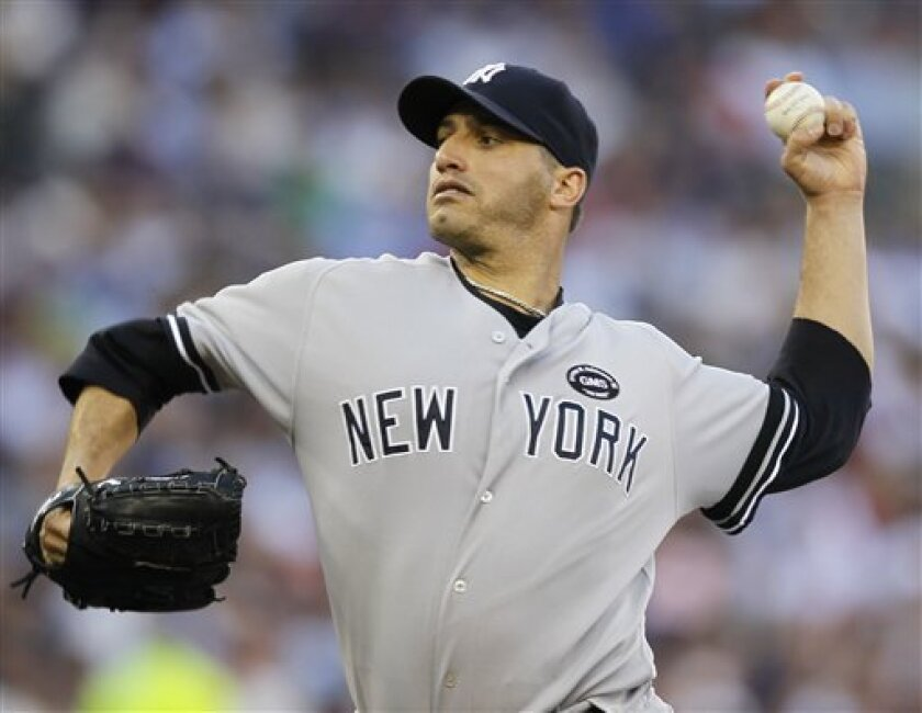 New York Yankees starting pitcher Andy Pettitte throws during the first inning of Game 2 of baseball's American League Division Series against the Minnesota Twins, Thursday, Oct. 7, 2010, in Minneapolis. (AP Photo/Charlie Neibergall)