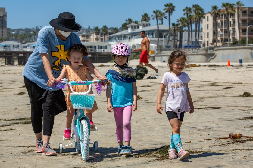 Shomit, Emma, Hodaya and Rachel Azolay go for a walk on the sand May 5 in Pacific Beach.