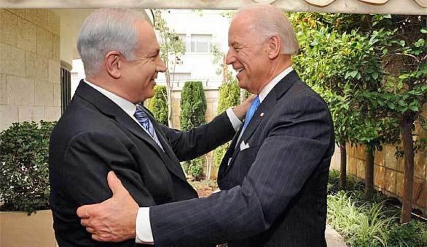 Then-Vice President Joe Biden embraces Benjamin Netanyahu, left, outside the Israeli leader's Jerusalem residence.
