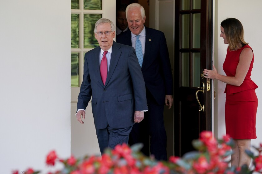 Senate Majority Leader Mitch McConnell and Senate Majority Whip John Cornyn leave the White House in Washington on July 19, 2017.