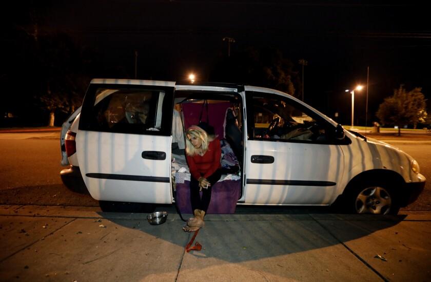 SAN GABRIEL VALLEY, CA JUNE 29, 2018: Andrea Colucci, 70, sits in the doorway of her van in San G