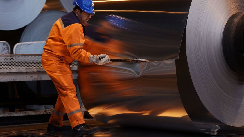 A worker cuts into an aluminium roll at the Constellium factory in the eastern French city of Biesheim.
