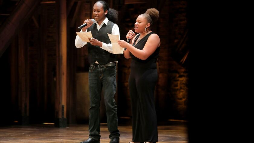 Hoover High School students Bernard Drake (left) and Alexis Harnage take the Civic Theatre stage to perform in EduHAM.