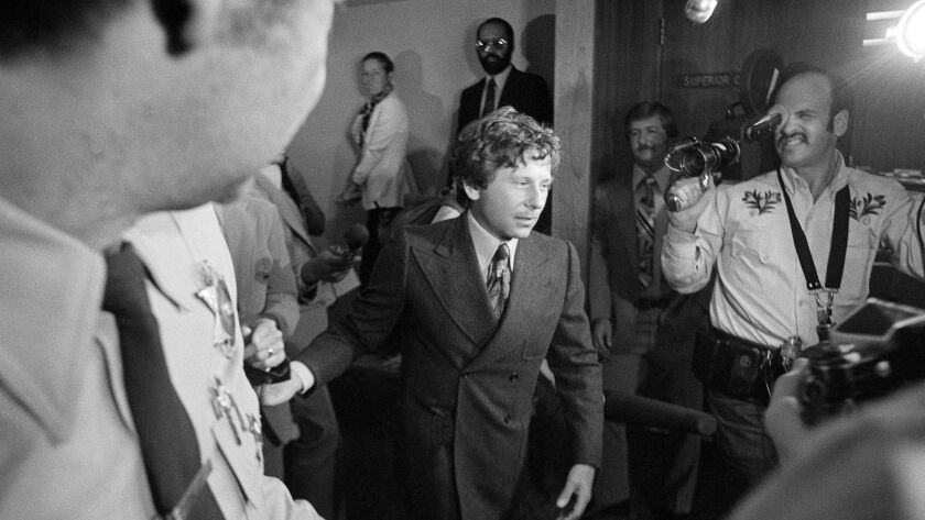Filmmaker Roman Polanski is shown leaving court in Santa Monica in 1977 after being ordered to undergo a 90-day diagnostic study at a state prison.