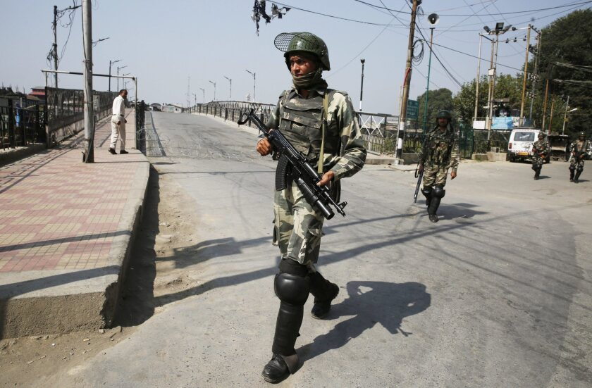 Indian paramilitary soldiers enforce a curfew in Srinagar, the summer capital of Indian Kashmir.