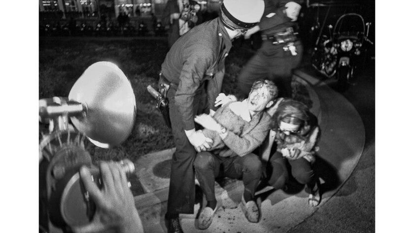 June 23, 1967: Police subdue anti-Vietnam War protesters outside Century Plaza Hotel.