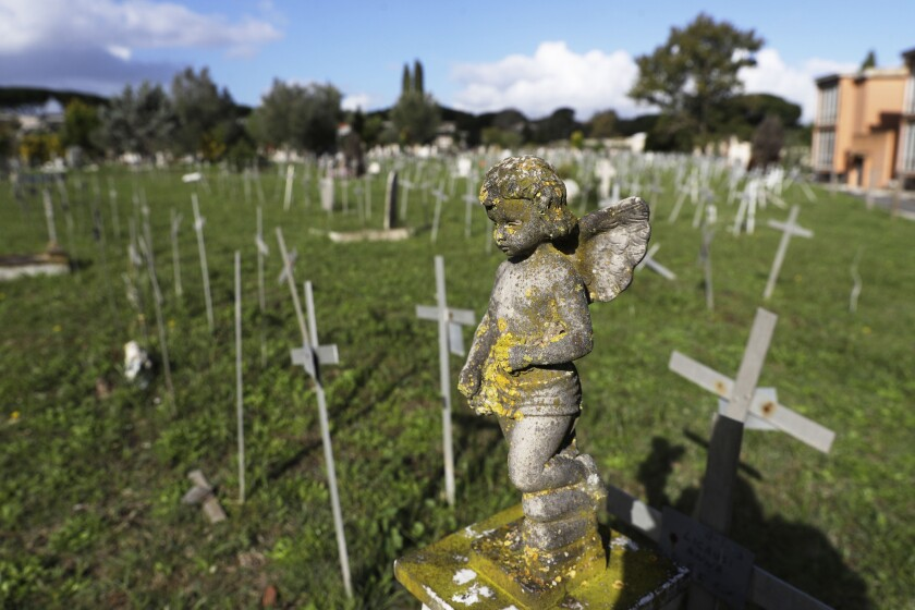 Crosses bearing tags with names are seen a graveyard of the Flaminio Cemetery, in Rome, Friday, Oct. 16, 2020. Italian prosecutors and the government's privacy watchdog are investigating how the names of women who miscarried or had abortions ended up on crosses over graves for the fetuses in a Rome cemetery. (AP Photo/Gregorio Borgia)