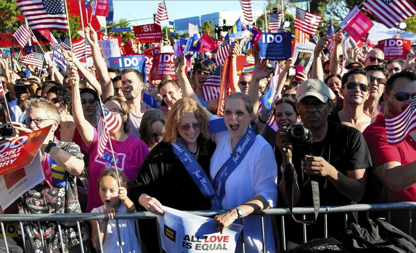 Same-sex marriage supporters in West Hollywood celebrate the Supreme Court ruling striking down California's Prop. 8 .