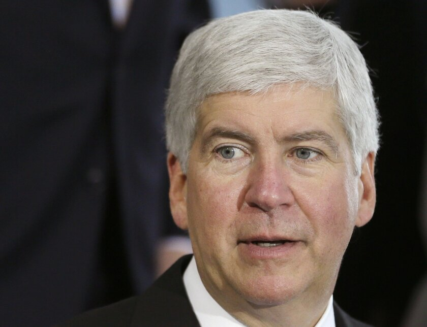 FILE - This June 20, 2014 file photo shows Michigan Gov. Rick Snyder during a ceremony in Detroit. Snyder on Thursday, June 11, 2015 signed a law letting private adoption agencies with state contracts decline to participate in referrals against their religious beliefs, despite criticism that it amo