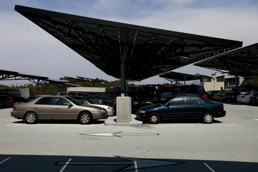 Photovoltaic panels double as sun shades for cars atop the Hopkins Parking Structure at UCSD. The panels are one small part of the university's attempt to become a national model for implementing new power technologies.
