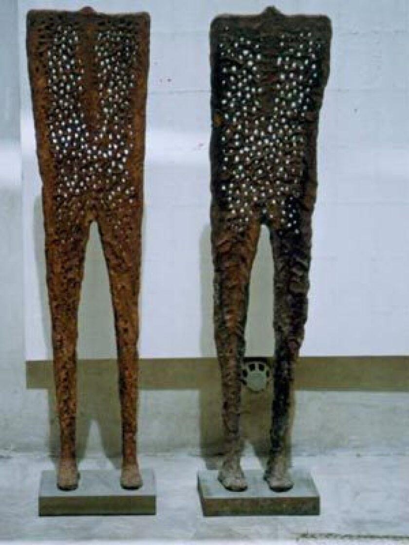 ON DISPLAY: A pair of headless metal sculptures with perforated bodies by Iraqi artist Halim Al Karim displayed at XVA Gallery in Dubai.