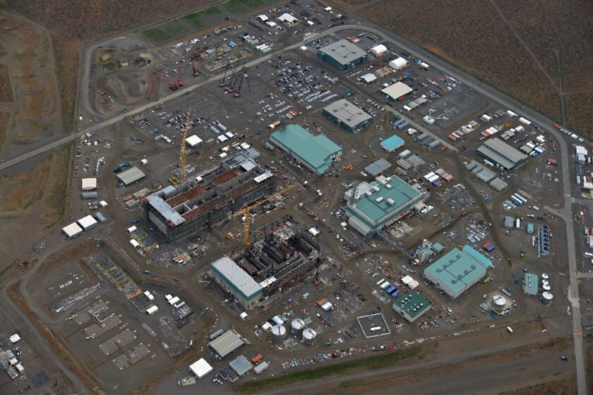 Construction of the massive Hanford site is shown in 2013. The cost of completing the plant to treat radioactive waste now stands at $16.8 billion.