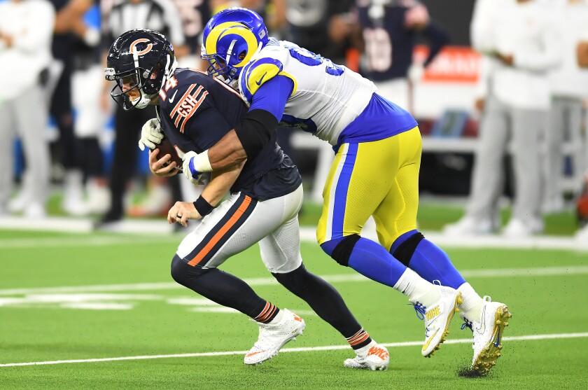Rams defensive lineman Aaron Donald sacks Bears quarterback Andy Dalton in the season opener.