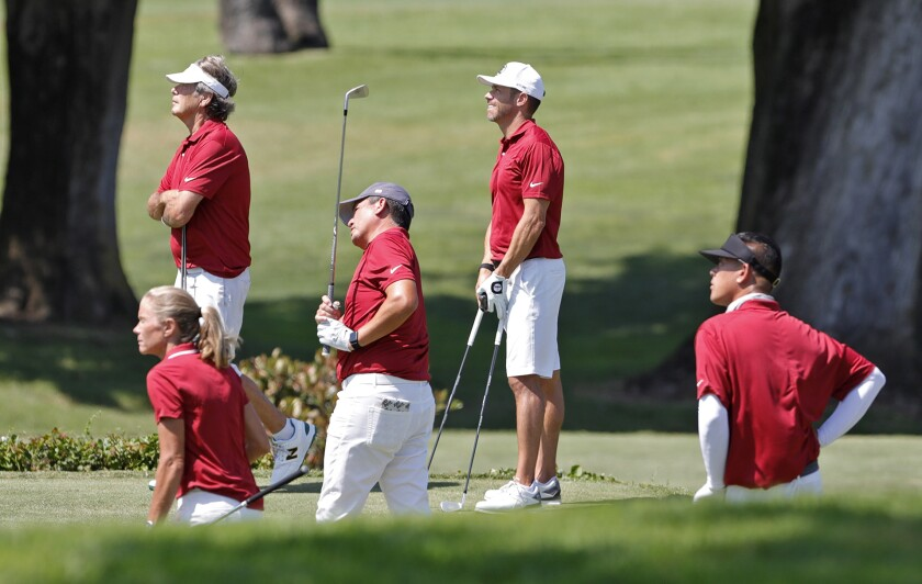 Teammates watch as Big Canyon team captain Robert Pang drives the ball during the 21st annual Jones Cup. - Mesa Verde's Kim Izzi Is Dizzy After Sinking Nine Birdies In Jones Cup Win - Los Angeles Times