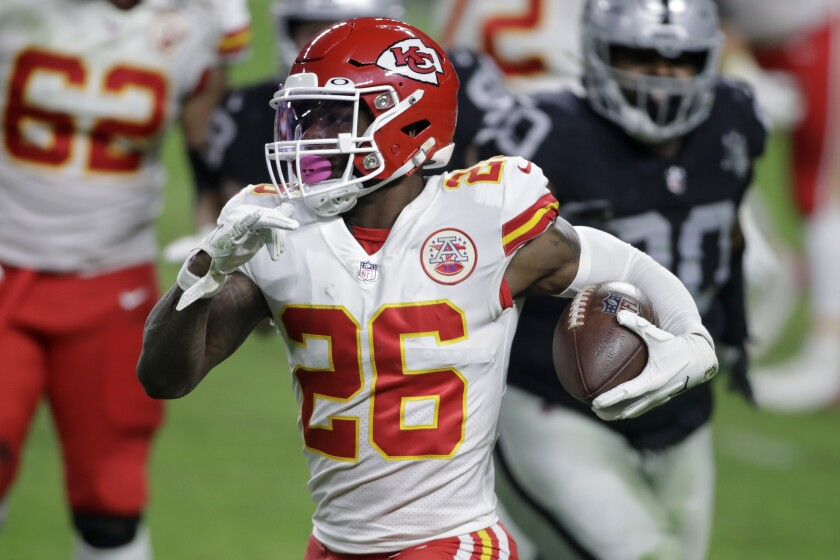 FILE - In this Nov. 22, 2020, file photo, Kansas City Chiefs running back Le'Veon Bell (26) carries the ball against the Las Vegas Raiders during the first half of an NFL football game in Las Vegas. The Baltimore Ravens signed Bell to their practice squad, adding another backfield option in the aftermath of J.K. Dobbins' season-ending injury. Bell was cut early last season by the New York Jets, then rushed for 328 yards in 11 games with Kansas City. He did not play in the Super Bowl for the Chiefs. (AP Photo/Isaac Brekken, File)