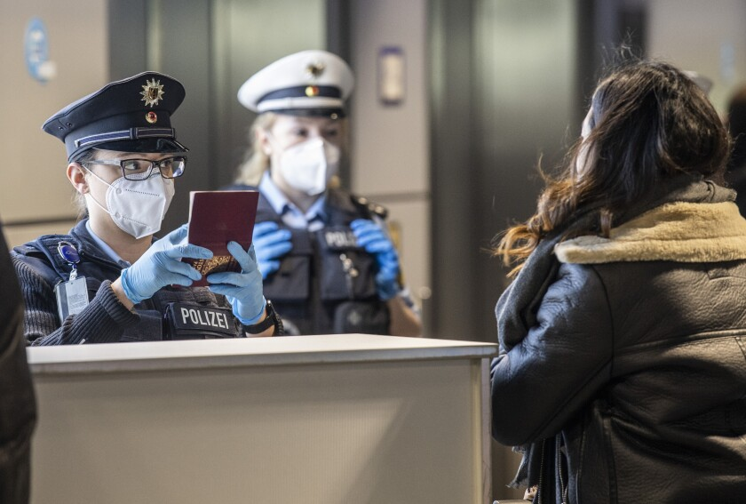 German Federal Police process passengers arriving in Frankfurt from Prague, the Czech capital.