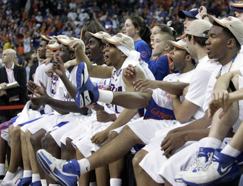 """FILE - In this April 2, 2007, file photo, Florida watches the """"One Shining Moment"""" video after winning the title game against Ohio State in the NCAA Final Four basketball championship in Atlanta. Florida won 84-75. Nearly everyone involved in the men's college basketball tournament, it seems, cherishes a """"One Shining Moment"""" memory. (AP Photo/Mark Humphrey, File)"""