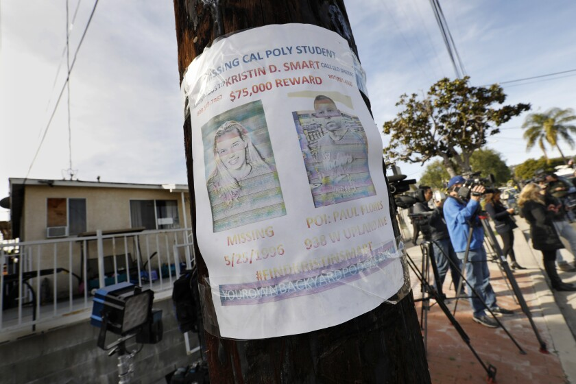 A missing person flyer is still posted on a telephone pole across the street from the home of Paul Flores in San Pedro