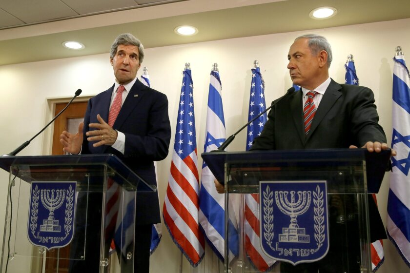 Israeli Prime Minister Benjamin Netanyahu, right, listens as U.S. Secretary of State John F. Kerry speaks during a news conference following a meeting Thursday at Netanyahu's Jerusalem office.