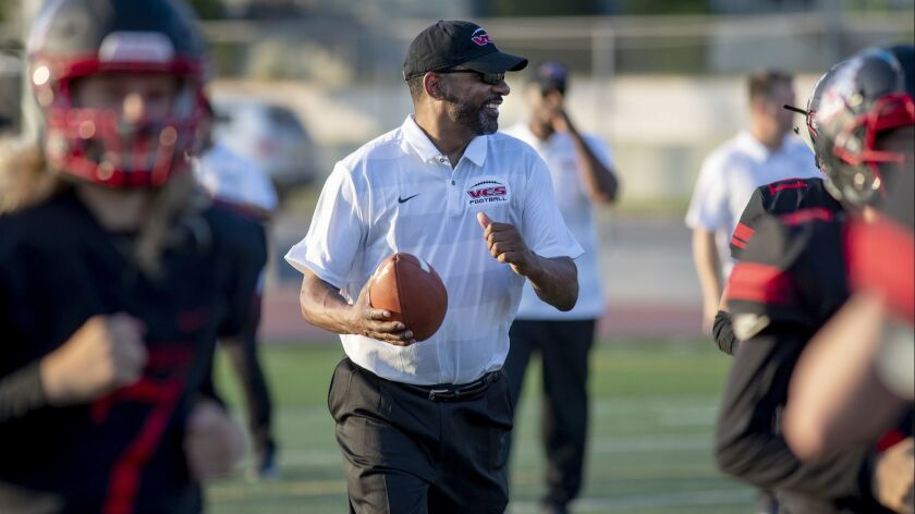Village Christian offensive line coach Todd McNair on the field in Burbank on Friday.