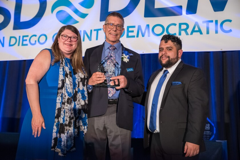 The Fallbrook Democratic Club received the San Diego County Democratic Party Club of the Year Award at the annual Roosevelt dinner. The California State Democratic Party will award the club the ability to select five members as delegates representing Fallbrook at the Pre-Endorsement Conference in October. Fallbrook Democratic Club President Tom Frew (center) receives the award from state Assemblywoman Tasha Boerner Horvath (left) and San Diego County Democratic Party Chairman Will Rodriquez-Kennedy.