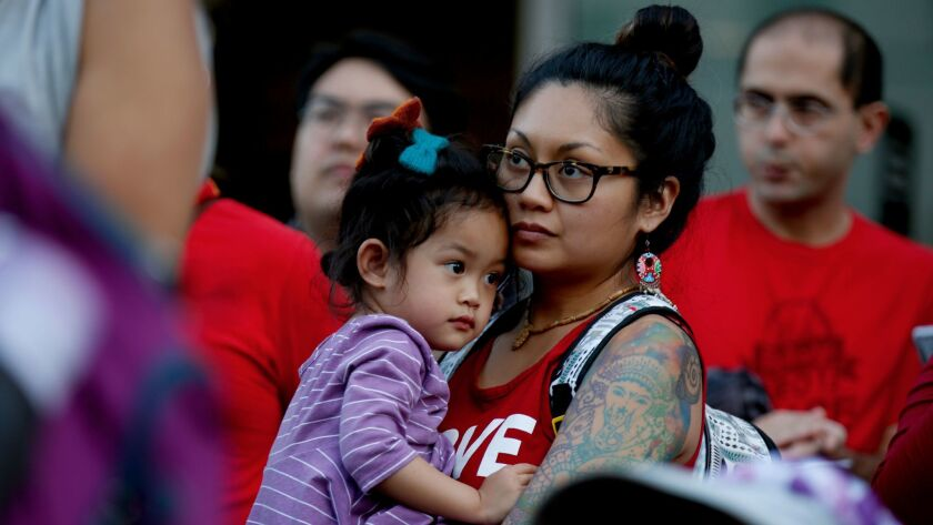 LOS ANGELES, CA MARCH 8, 2017: Katherine Conchada, right, holds her daughter Padma Ferrer 4, left,