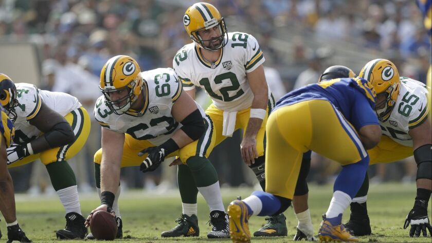 Green Bay Packers quarterback Aaron Rodgers starts a play during the first half of an NFL football g
