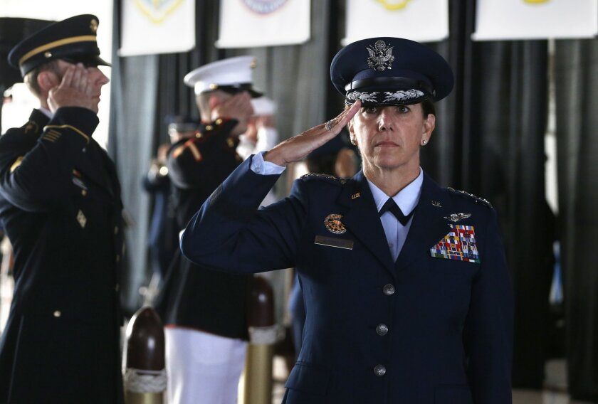 Air Force Gen. Lori J. Robinson, the incoming commander of the North American Aerospace Defense Command and U.S. Northern Command, salutes during her arrival at the change of command ceremony, at Peterson Air Force Base, in Colorado Springs, Colo., Friday, May 13, 2016. Gen. Robinson is the first w