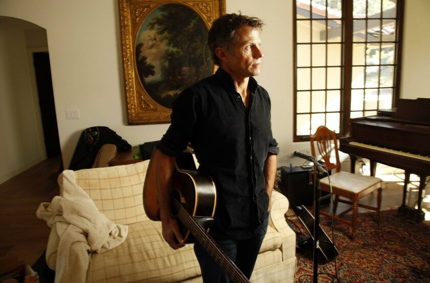 "North County singer/songwriter/author Alex Woodard in the music room of his Rancho Santa Fe home. On Veterans Day, he released ""For the Sender: Love Letters from Vietnam,"" a book and CD inspired by the true story of a troubled Vietnam veteran and his grieving daughter."
