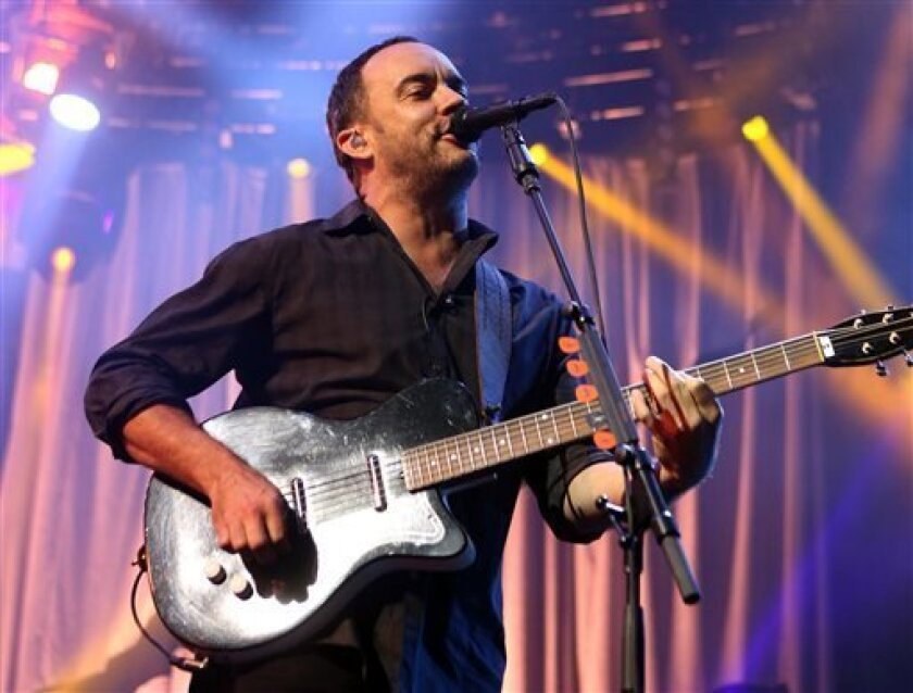 FILE - In this June 28, 2013 file photo, South African-born Dave Matthews of The Dave Matthews Band performs on stage at the Susquehanna Bank Center in Camden, N.J.