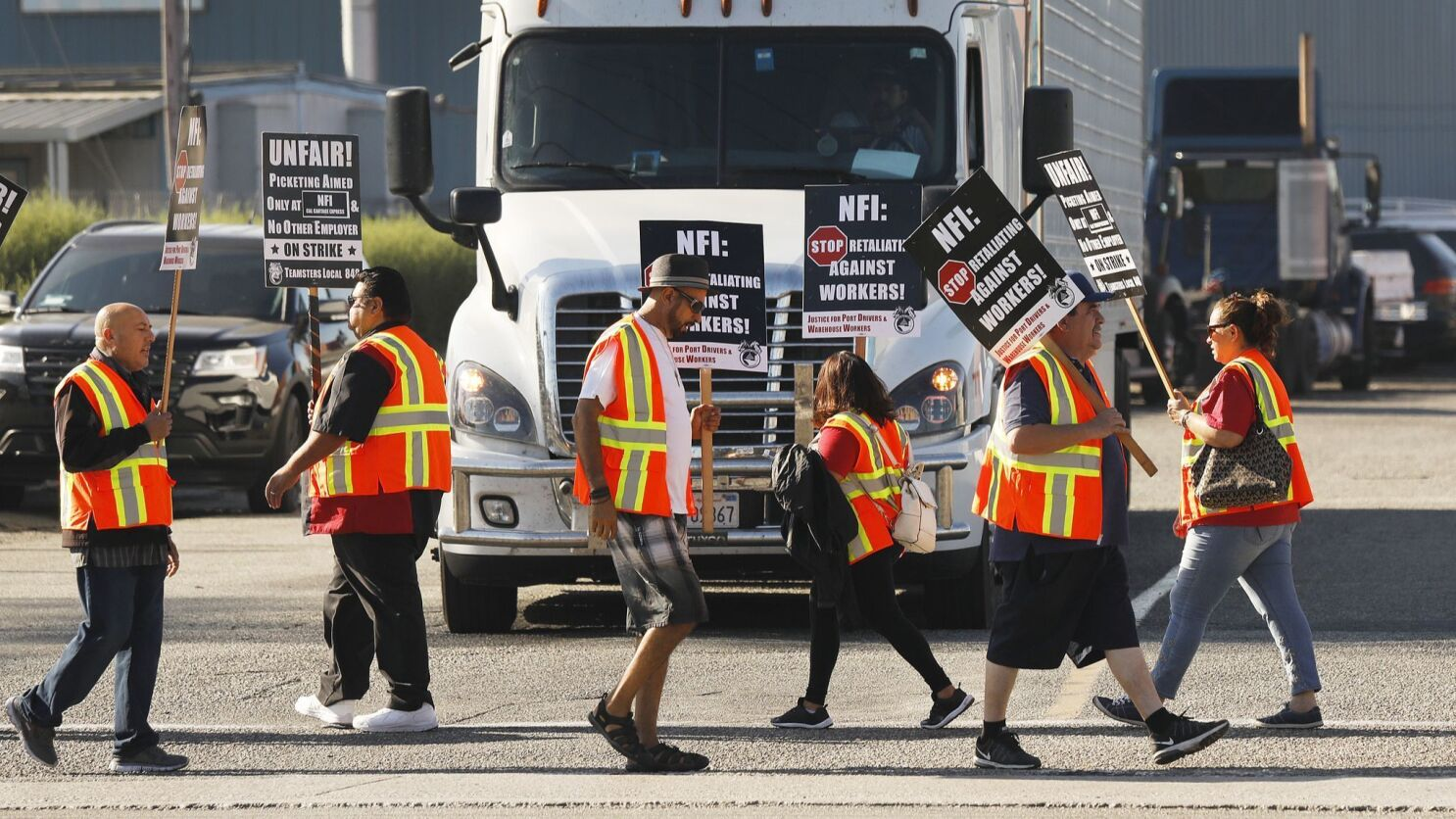 L A  and Long Beach port truckers and warehouse workers