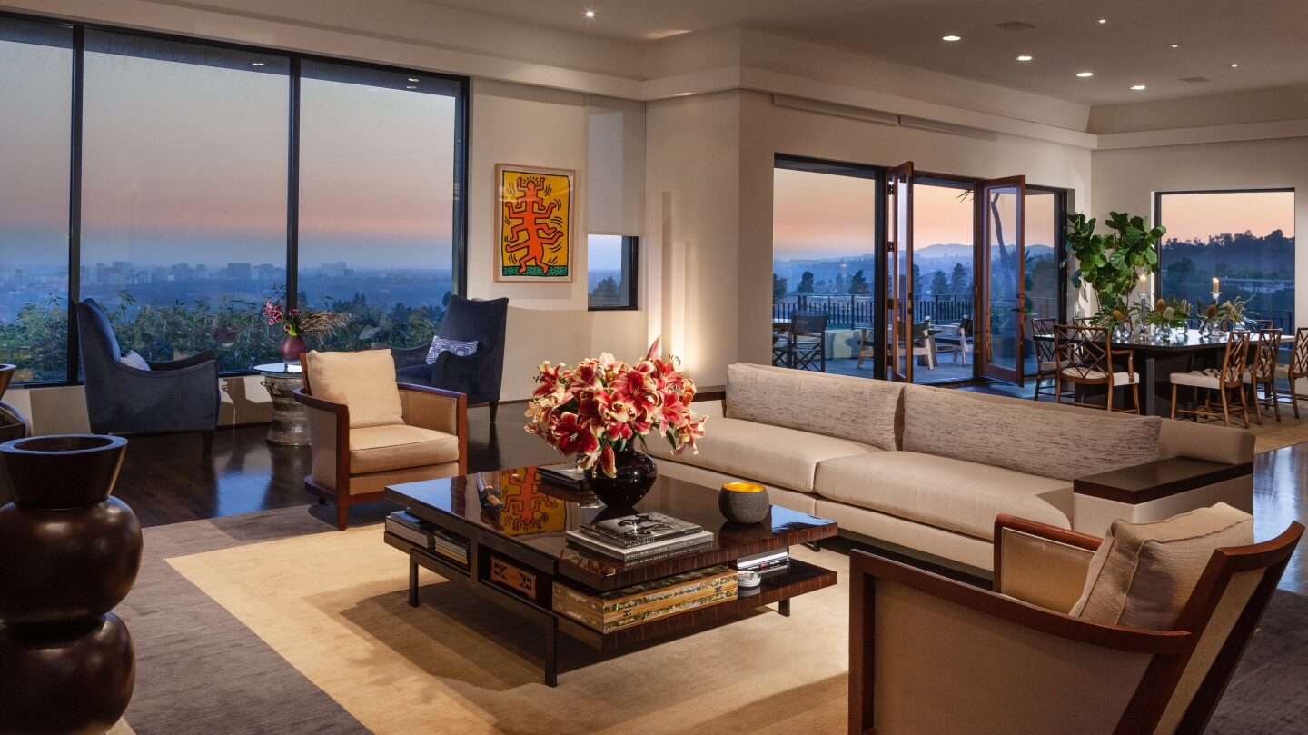 The 8,100-square-foot showplace includes a movie theater, gym and multiple terraces overlooking the city below.